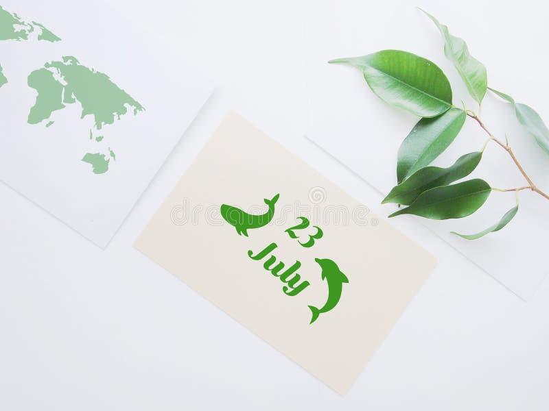 Эмблема дня дельфина кита мира 23-ье июля стоковые изображения