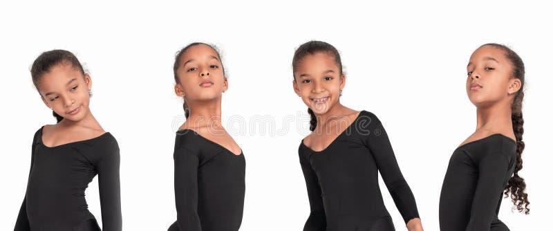 Эмоциональная талия вверх по портретам маленькой девочки мулата в гимнастическом костюме на белой предпосылке в студии стоковое фото