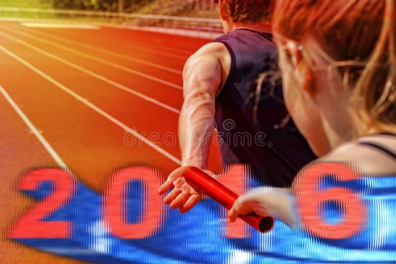 Эстафетный бег вручая над 2016 стоковая фотография rf
