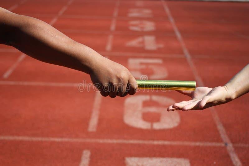 Эстафетный бег стоковое изображение