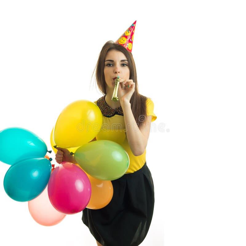 Элегантная красивая девушка имея потеху на вечеринке по случаю дня рождения стоковое фото