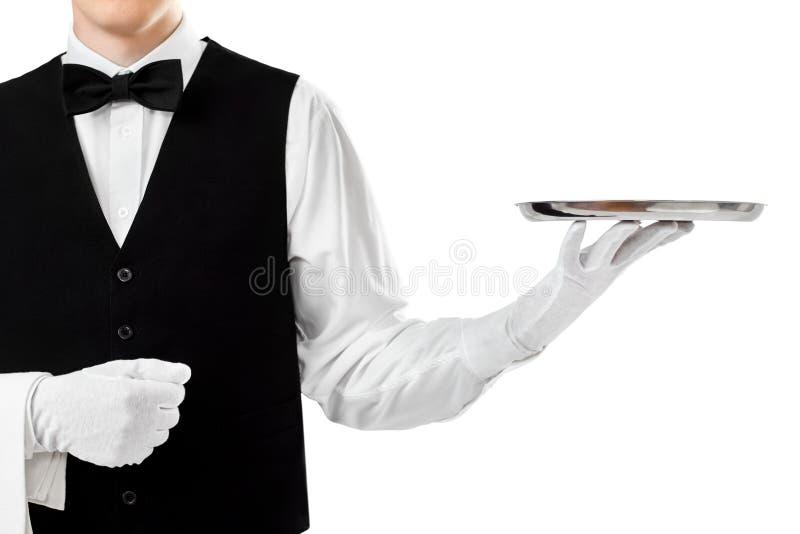 Элегантный кельнер держа пустой серебряный поднос стоковое изображение rf