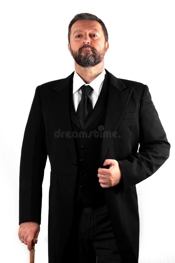 Элегантный человек на белой предпосылке стоковое изображение