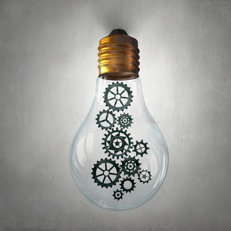 Электрическая лампочка с колесами шестерни стоковое изображение