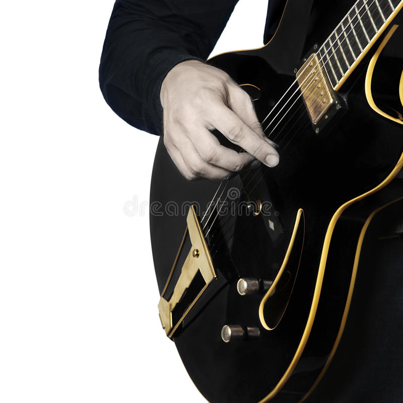 Электрическая гитара вручает крупный план стоковое изображение rf