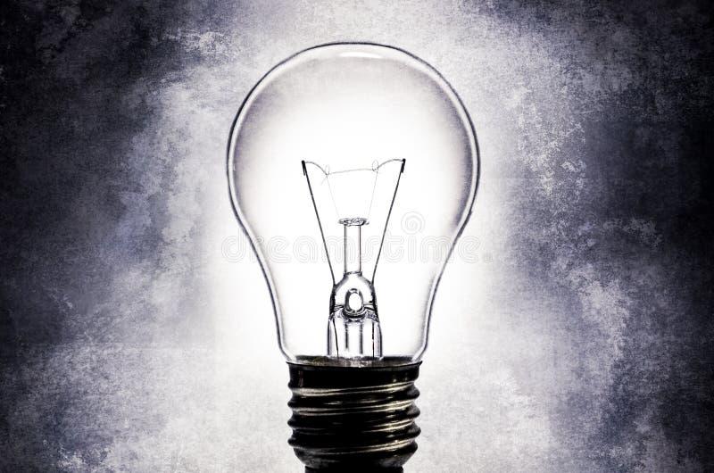 Электрическая электрическая лампочка с предпосылкой текстурированной светом стоковая фотография