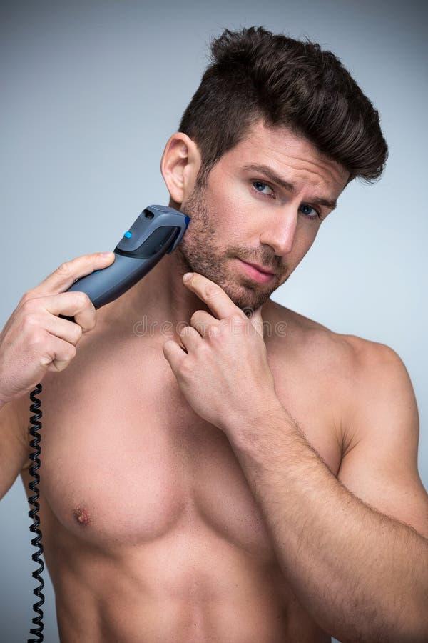 электрический брить бритвы человека стоковое изображение