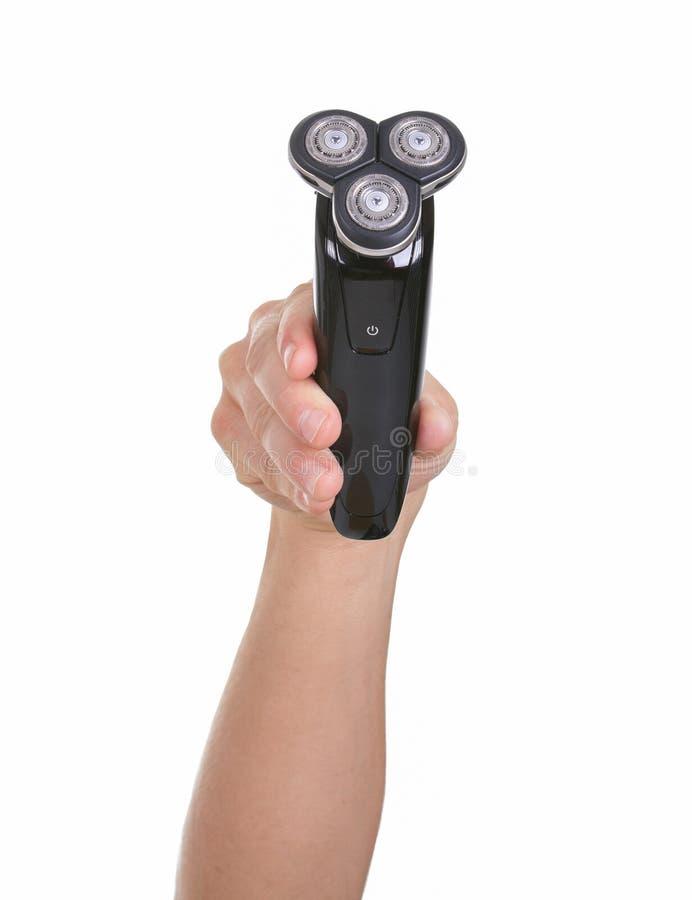 Электробритва в руке на белой предпосылке стоковая фотография rf