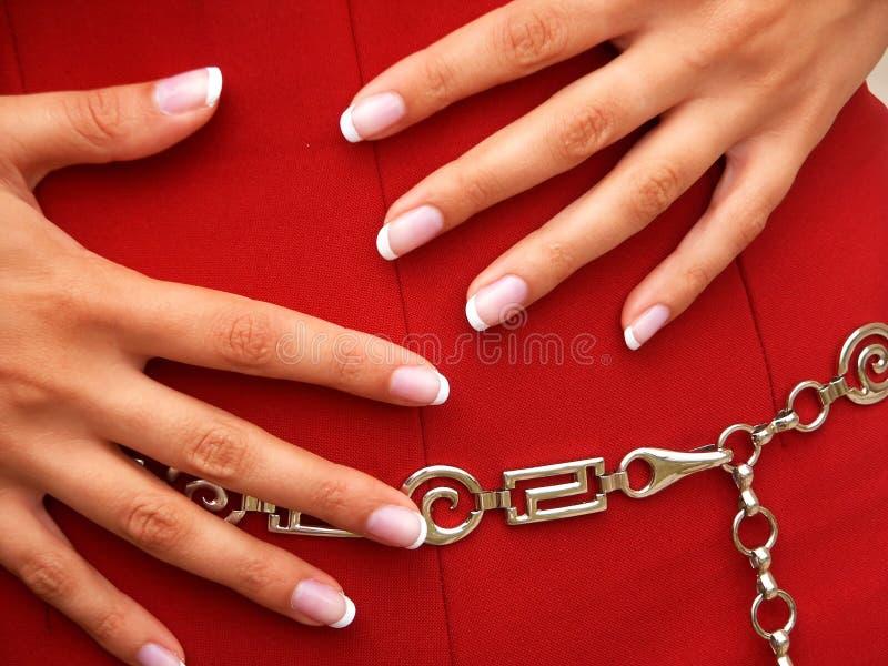 юбка женских рук красная Стоковое Изображение