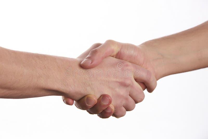 2 люд тряся руки над изолированной белой предпосылкой стоковая фотография