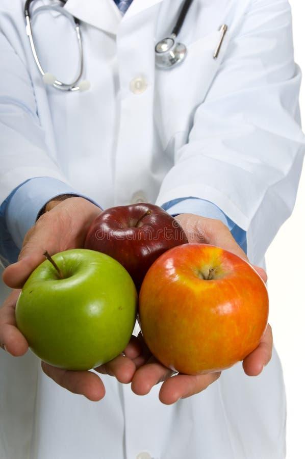 яблоки врачуют ободрять стоковые фото