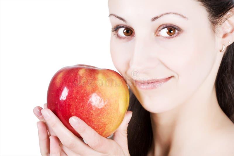яблоко есть женщину стоковые фото