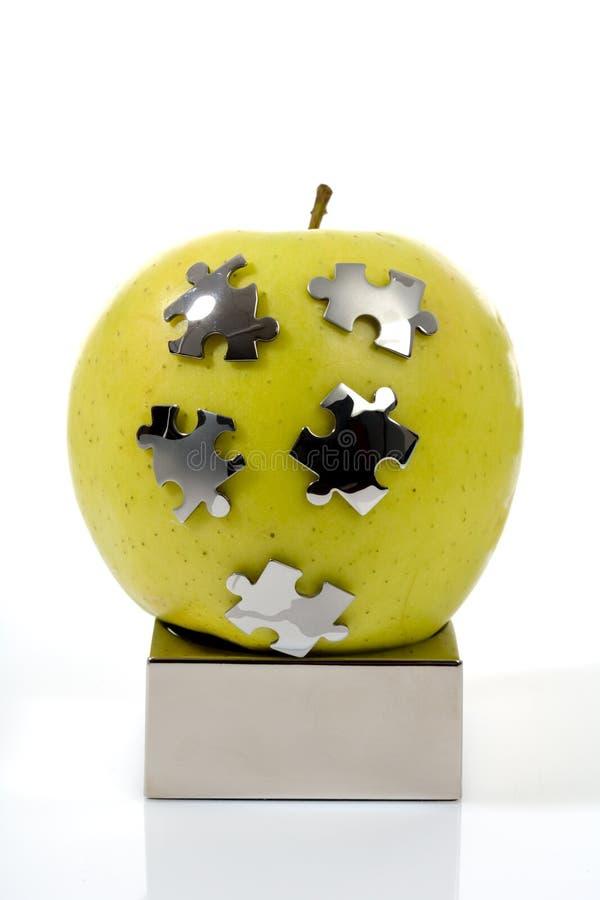 яблоко - зеленая головоломка стоковое фото