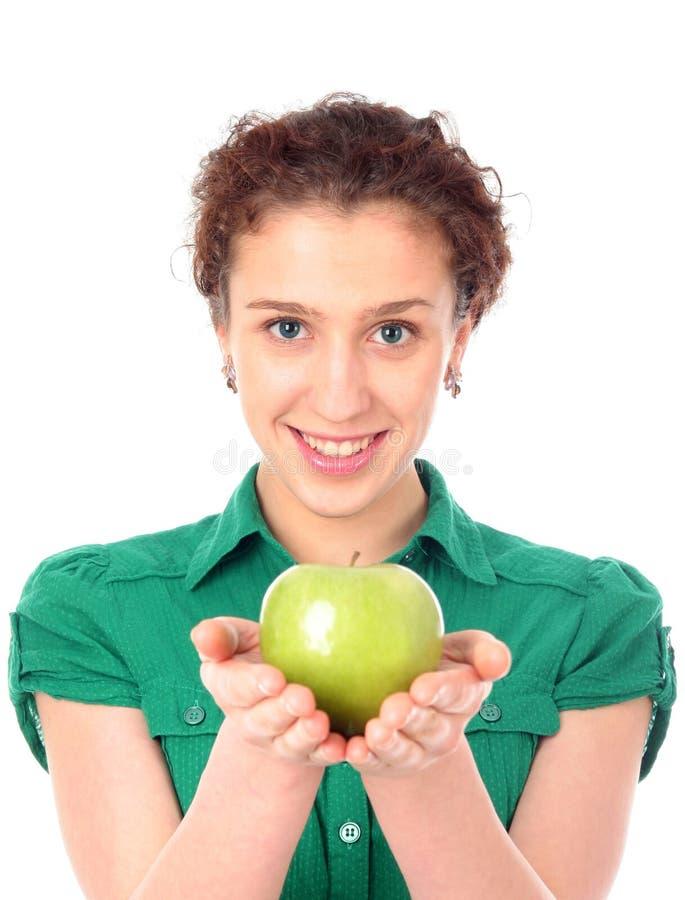 яблоко - зеленая женщина удерживания стоковое изображение rf