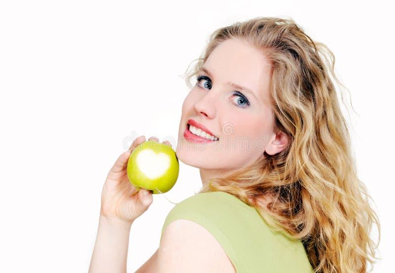яблоко - зеленый цвет задерживает женщину стоковое изображение