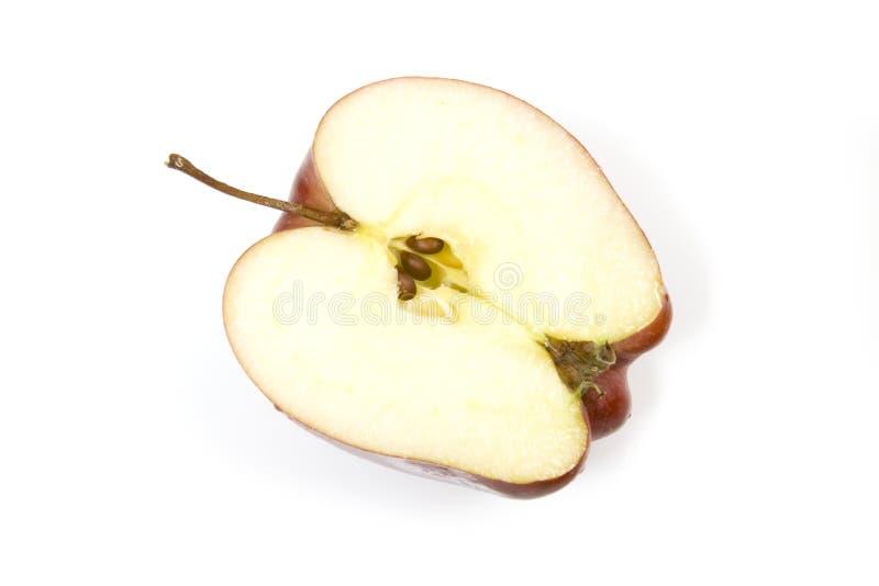 яблоко halved стоковые изображения