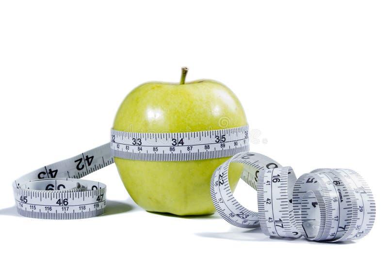 яблоко - зеленая лента измерения стоковое изображение