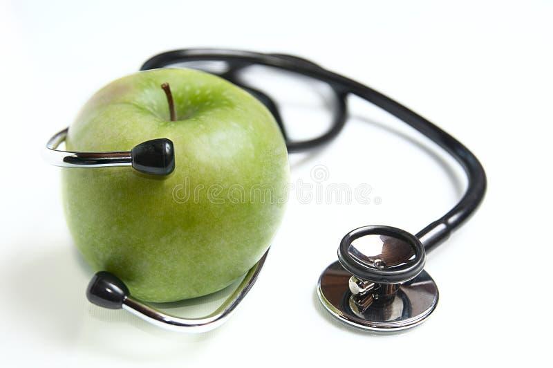 Яблоко и stetoskop стоковое фото