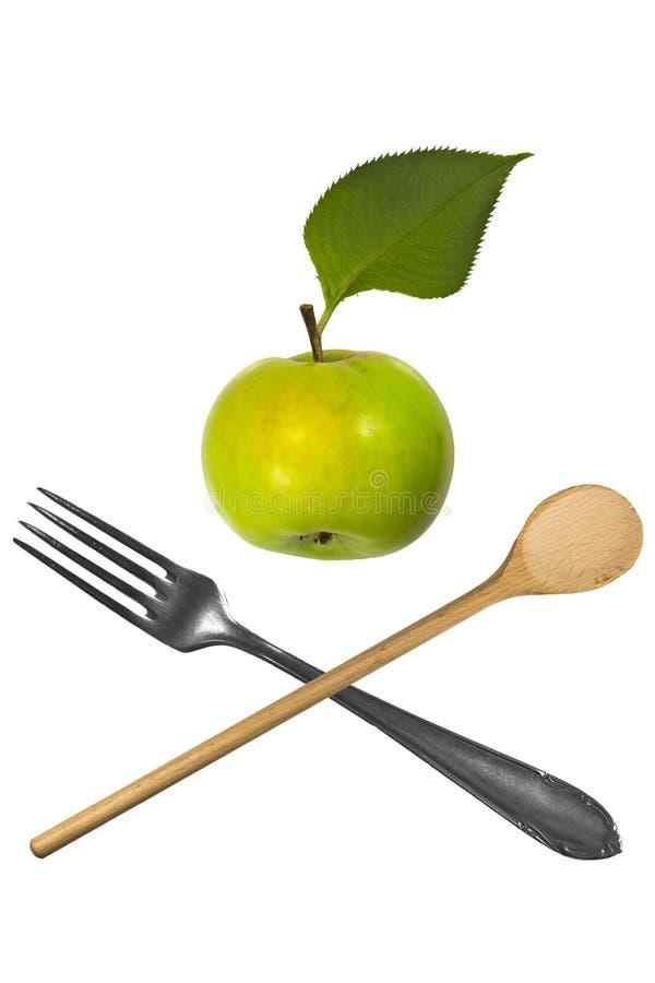 Яблоко с вилкой и ложкой стоковое фото rf