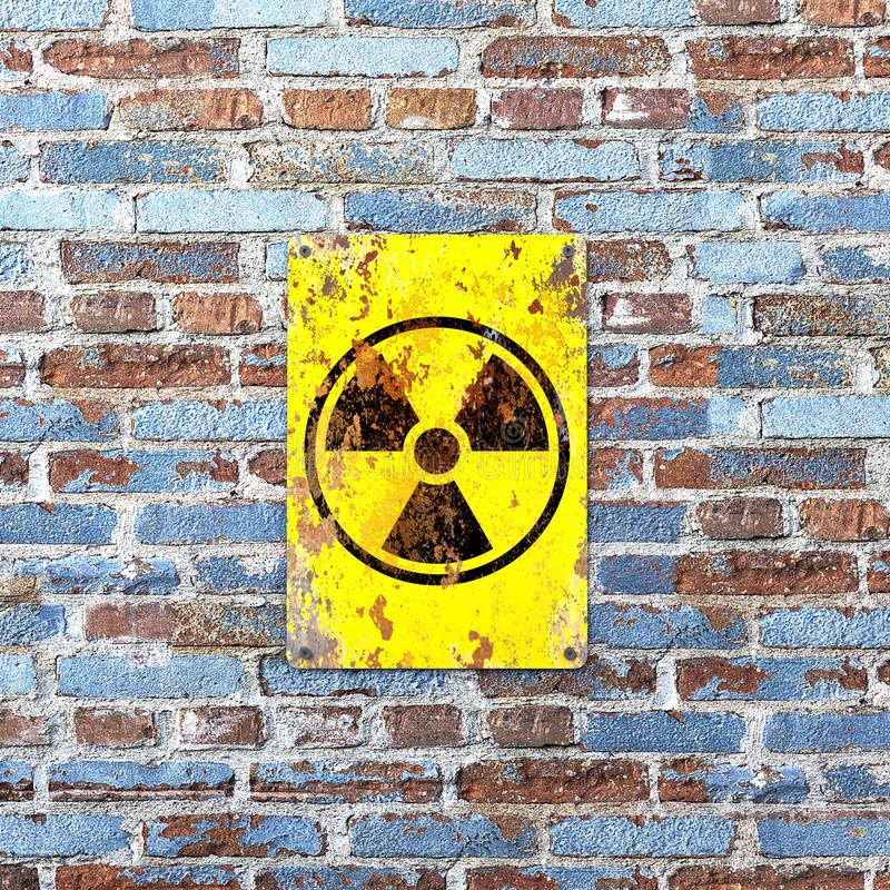Ядерный объект, знак вися на кирпичной стене Индикация присутсвия радиоактивной области иллюстрация штока