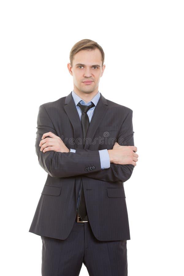 Язык жестов человек в белизне изолированной деловым костюмом стоковая фотография