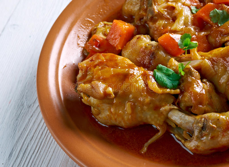 Ямайский цыпленок тушёного мяса Брайна стоковая фотография