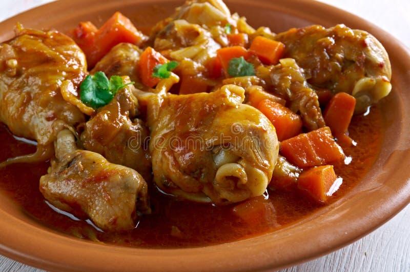 Ямайский цыпленок тушёного мяса Брайна стоковое фото