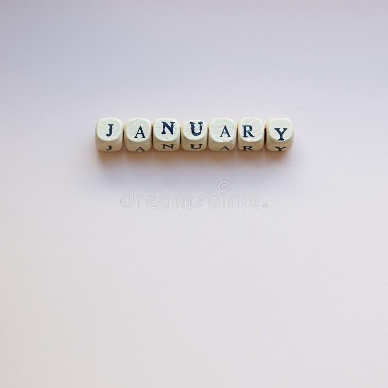 Январь на cream предпосылке стоковые изображения