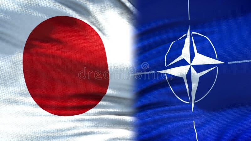 Япония и предпосылка флагов НАТО, дипломатический и экономические отношения, безопасность стоковые изображения rf