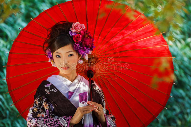 Японская женщина с платьем кимоно стоковая фотография rf
