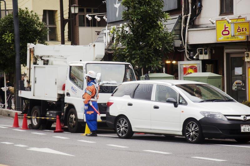 Японский работник электрика столичного электричества Authorit стоковое фото