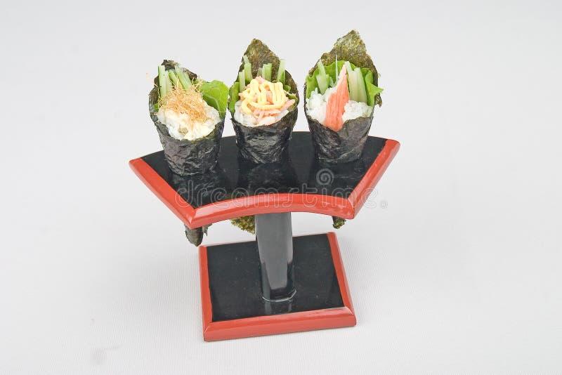 японцы руки еды свертывают суши стоковое изображение rf