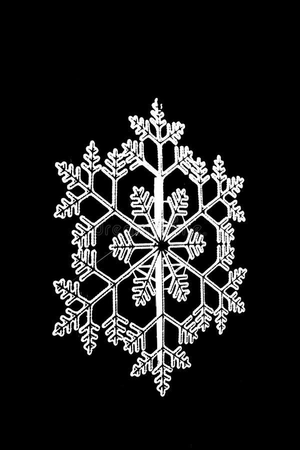 Яркая белая снежинка от стороны стоковое изображение rf