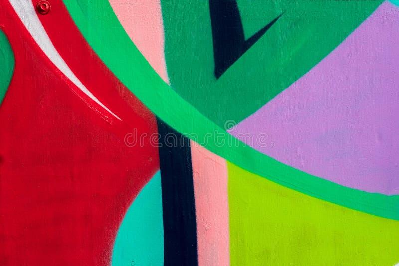 Яркая часть стены с деталью граффити, искусства улицы Абстрактные творческие цвета моды чертежа Современное иконическое стоковые изображения