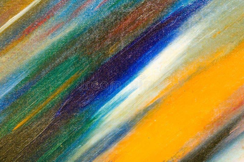 Яркие желтые и голубые цвета на холсте покрытом с sequins стоковое фото