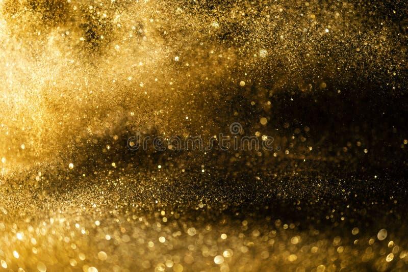 Яркий блеск освещает предпосылку grunge, предпосылку светов яркого блеска золота defocused абстрактную Twinkly стоковое изображение rf