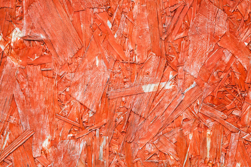 Яркий покрашенный красный цвет ориентировал доску OSB стренги стоковые изображения