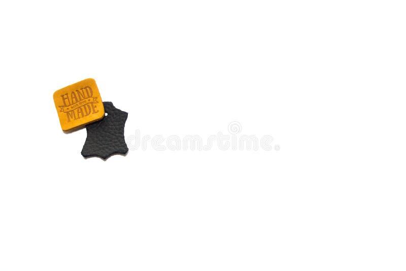 Ярлыки черных и золота кожаные handmade изолированные на белой предпосылке стоковая фотография