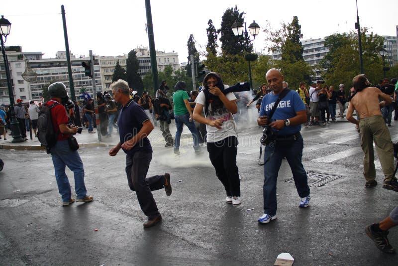 Яростные clashes во время посещения Merkel в Афиныы стоковое фото