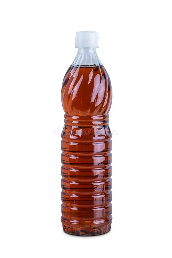 Ясная пластиковая бутылка соуса рыб изолированная на белой предпосылке стоковое фото rf