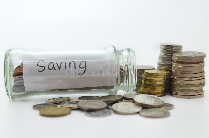 Ясный стеклянный опарник для подсказок с деньгами стоковые изображения
