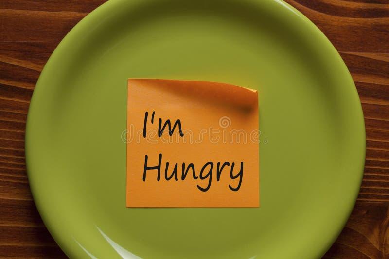 Я голодные написанный на концепции примечания стоковое фото rf