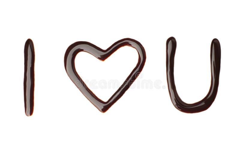 Я тебя люблю жидкостный знак шоколада стоковое фото