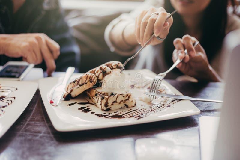 ํYoung Woman and men meet at the Cafe for a coffee and to talk stock photo