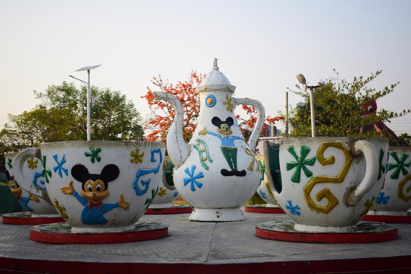 tea cup with saucer and tea pot ride in rajshahi zia  shihu park. Tea cup saucer pot ride rajshahi zia    shihu park beautiful amazing royalty free stock images