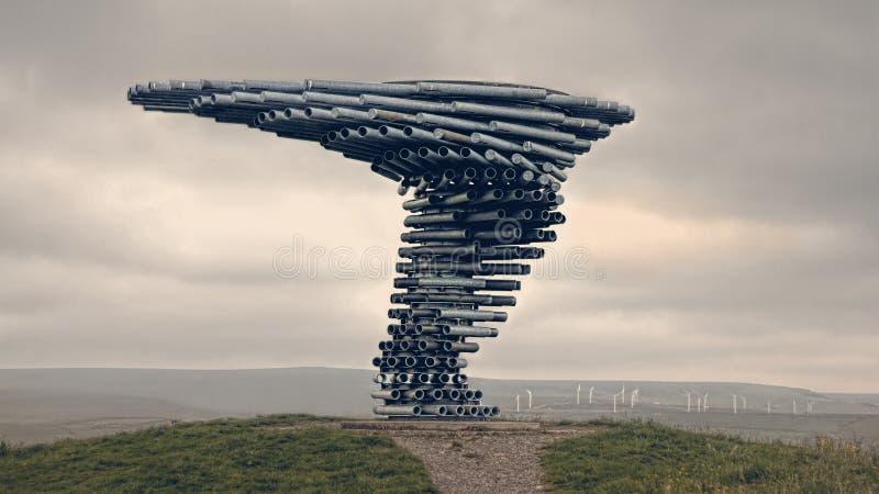 '唱歌敲响的树'唱歌雕塑 伯恩利,兰开夏郡英国 库存图片