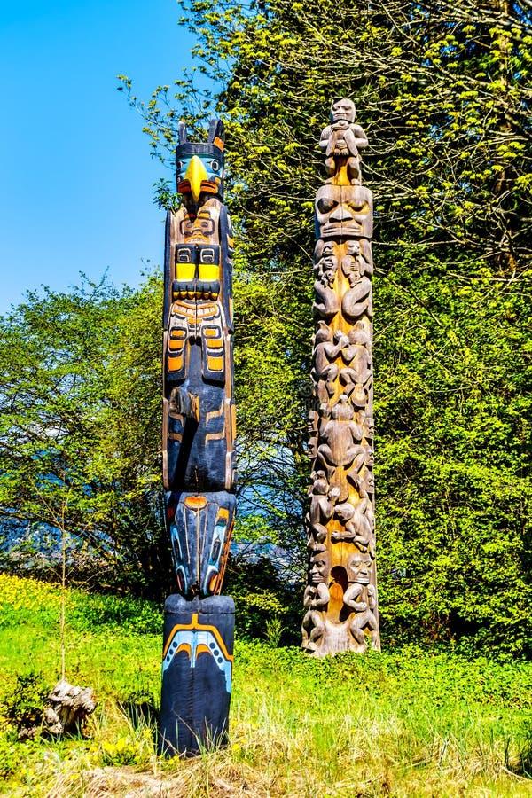 '奥斯卡Maltipi标识杆'和'海狸冠标识杆'在史丹利公园 免版税库存图片