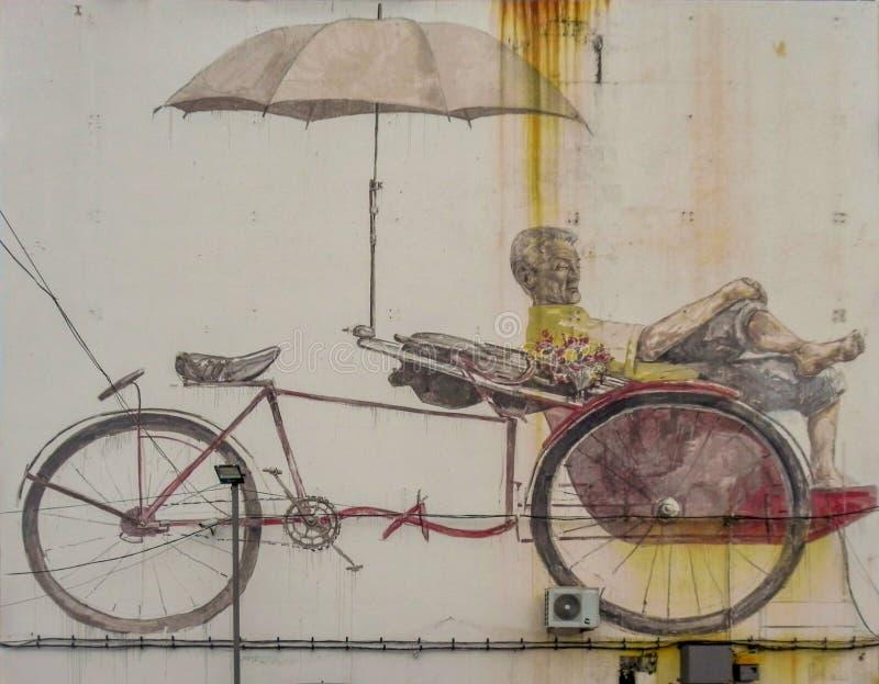 'Pintura mural da arte da rua do Paddler de espera de Trishaw 'pintada pelo artista lituano Ernest Zacharevic em George Town, Pen imagem de stock