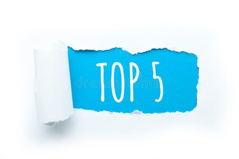 'Top 5 'met een breuk van document op een witte achtergrond Een selectie van verbazende feiten stock foto's