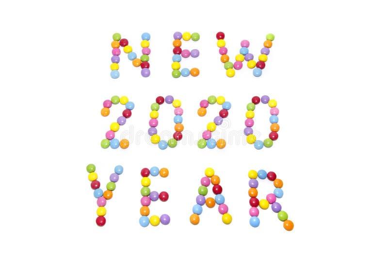 """""""Νέο δύο χιλιάες εικοστές έτος """"από την πολύχρωμη καραμέλα γλυκών στοκ φωτογραφία"""